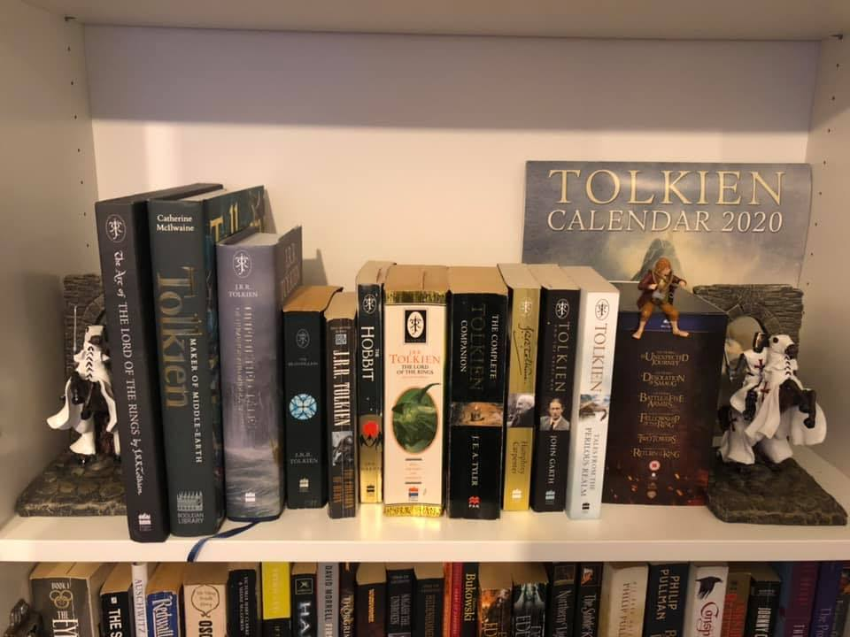 Lots of Tolkien books on a shelf
